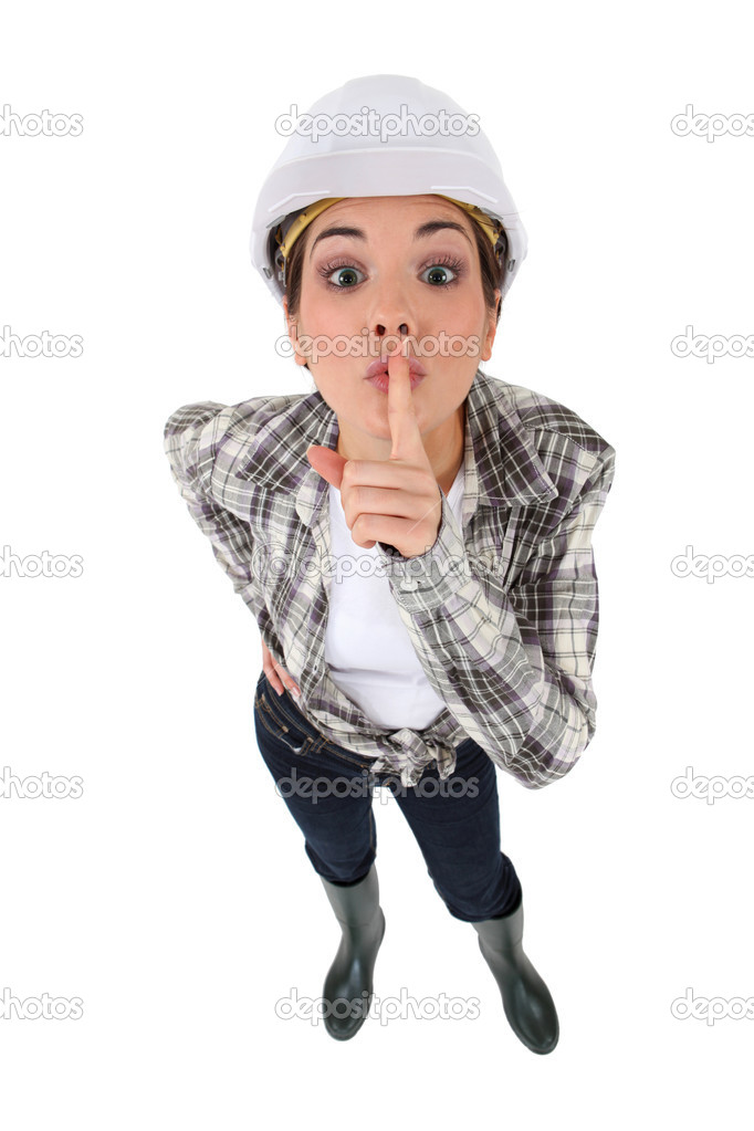 Young craftswoman with finger before mouth to keep a secret  Stock Photo #8563837