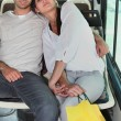 Stock Photo: Couple embraced inside bus
