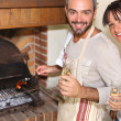 Couple having nice time near the fireplace — Stock Photo #8572389
