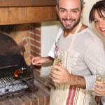 Couple having nice time near the fireplace — Stock Photo