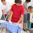 Young men doing their household chores — Stock Photo