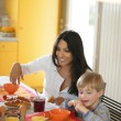 Mother and son at the breakfast table — Stock Photo