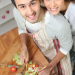 Top-view of couple making salad — Stock Photo #8574207