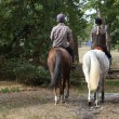 Couple riding in the countryside — Stock Photo