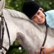 Stock Photo: Young womand her horse