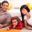 Parents and a little boy drawing — Stock Photo