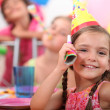 Young girl at a child's birthday party - Stock Photo