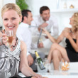 Woman with glass of champagne — Stock Photo #8575944