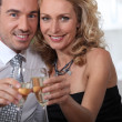 Couple celebrating at home with champagne — Stock Photo