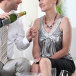 Two smartly dressed about to drink champagne. — Stock Photo #8576037