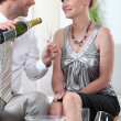 Two smartly dressed about to drink champagne. — Stock Photo