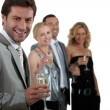 Two couples drinking champagne — Stock Photo #8576053