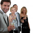 Two couples drinking champagne — Stock Photo