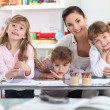 Mother drawing with three daughters — Stock Photo #8576295