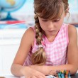 Little girl drawing at school - Foto Stock