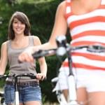 Young women riding bikes — Stock Photo #8577002