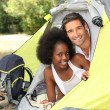 Couple with tent on camp site — Stock Photo