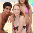 Friends at the beach — Stock Photo #8577230