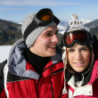 Couple at ski season — Stock Photo