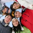 Group of teenagers in a circle — Stock Photo