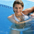 Hot blond woman in the swimming pool — Stock Photo