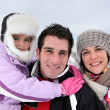 Family outing on a winter's day — Stockfoto