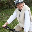 Older woman riding her bicycle — Stock Photo #8577907