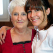 Stock Photo: Portrait of a senior woman and a smiling young woman