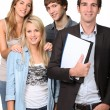 Stock Photo: Adult and teenagers smiling