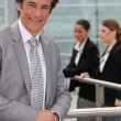 Stock Photo: Businessman standing outside