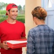 Man delivering pizza — Stock Photo