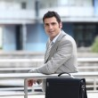 Businessman with briefcase in an urban environment — Stock Photo #8579994
