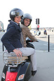 A couple riding a scooter — Stock Photo
