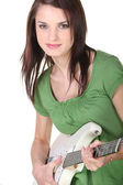 Young woman playing the electric guitar — Stock Photo
