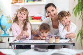 Mother drawing with three daughters — Stock Photo