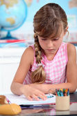 Little girl drawing at school — Stock Photo
