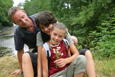 Family portrait in the forest — Stock Photo