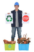 Builder with recyclable materials — Stock Photo