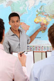 Students observing a world map — Stock Photo