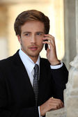 Young businessman on phone — Stock Photo