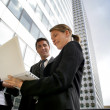 Young business using laptop outside of the office — Stock Photo
