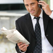 Ceo on phone with newspaper — Stock Photo #8580397