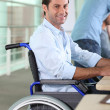 Royalty-Free Stock Photo: Man working in a wheelchair