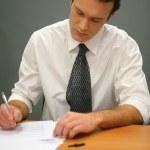 zakenman schrijven — Stockfoto