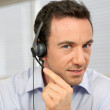 Male telemarketer at work - Stock Photo