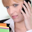 Unhappy woman talking on phone — Stock Photo #8581628