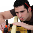 Stock Photo: Woodworker working on board