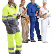 Group of workers with one in the foreground — Stock Photo
