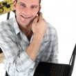 Handyman with a laptop and telephone — Stock Photo #8584228