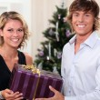 Couple with a Christmas gift — Stock Photo